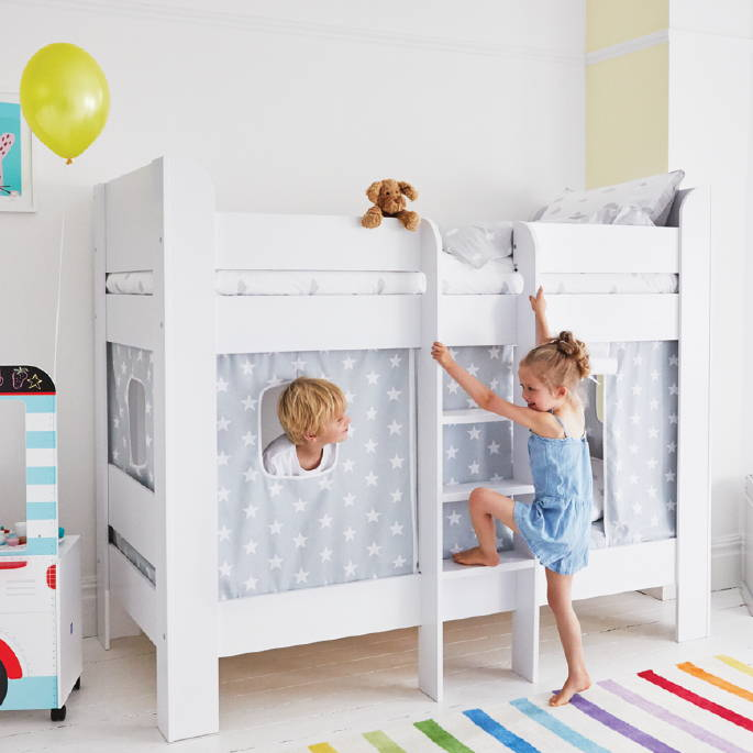 White bunk bed with play curtains