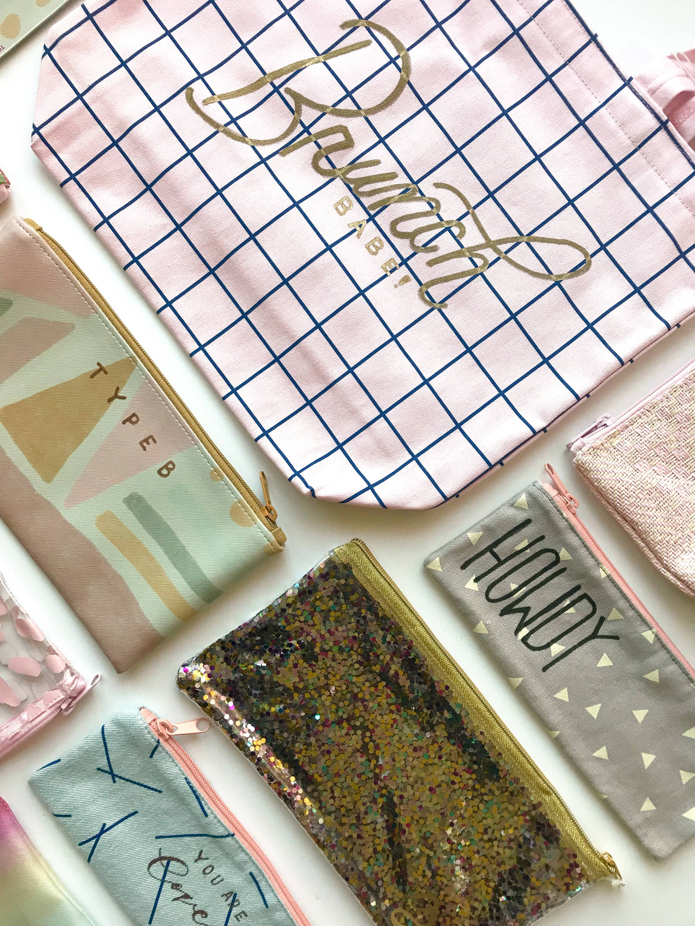 Cute pencil pouches with Viv Jordan's hand lettering designs.