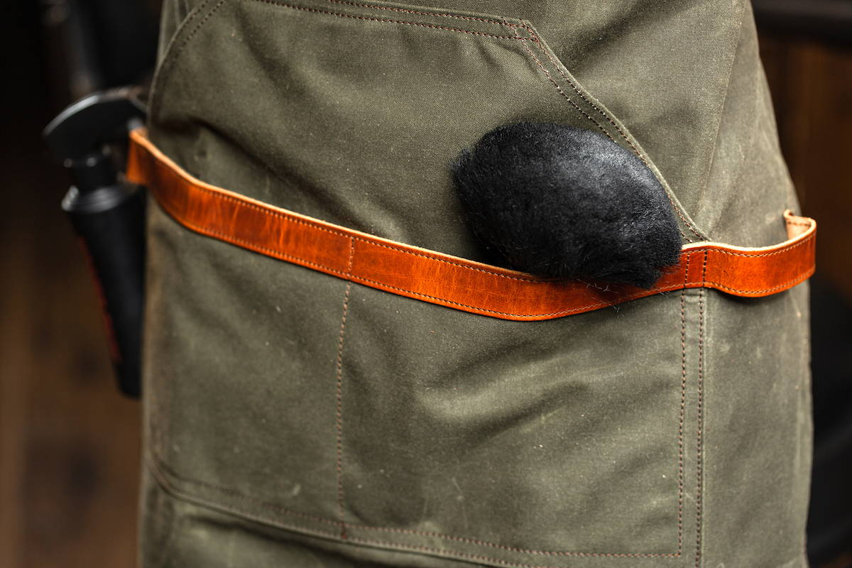 green berber apron in waxed canvas and leather