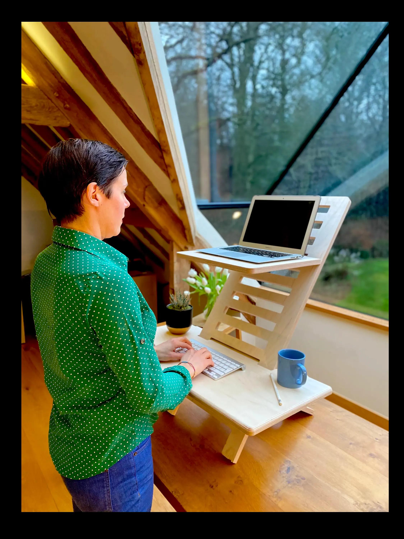 Woman in window with Helves sit standing desk