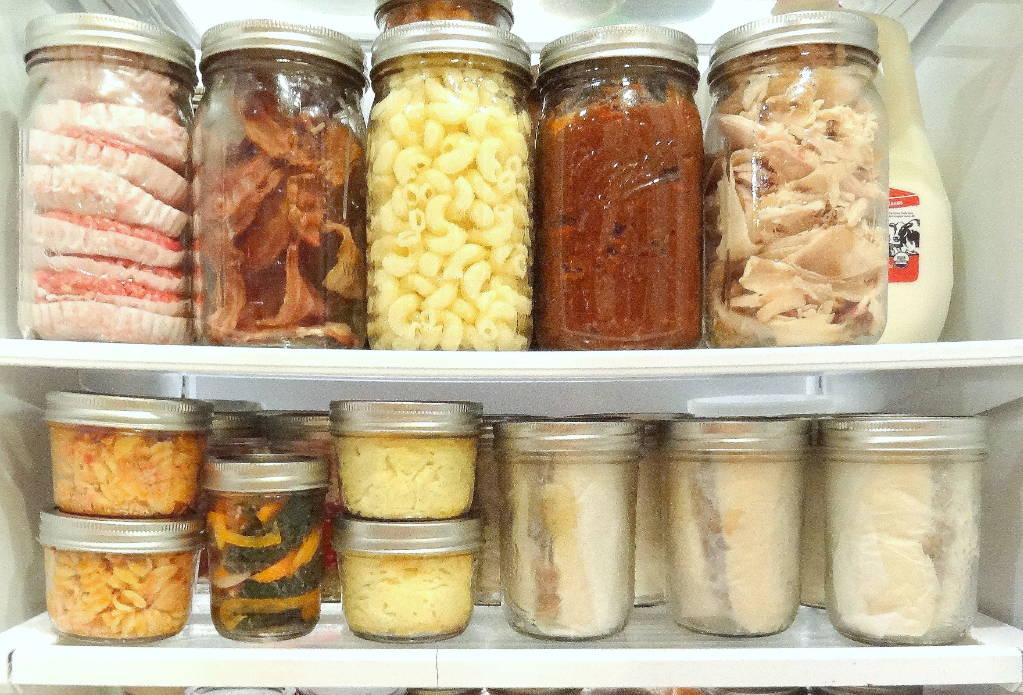 Jars of herb infused foods in refridgerator