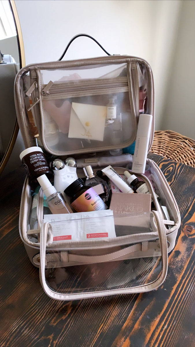 CALPAK Clear Cosmetics Case in Stone with Giselle's skincare and makeup essentials.