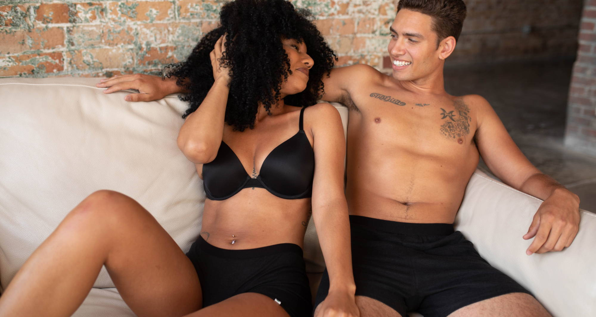 couple sitting on the couch in WAMA underwear