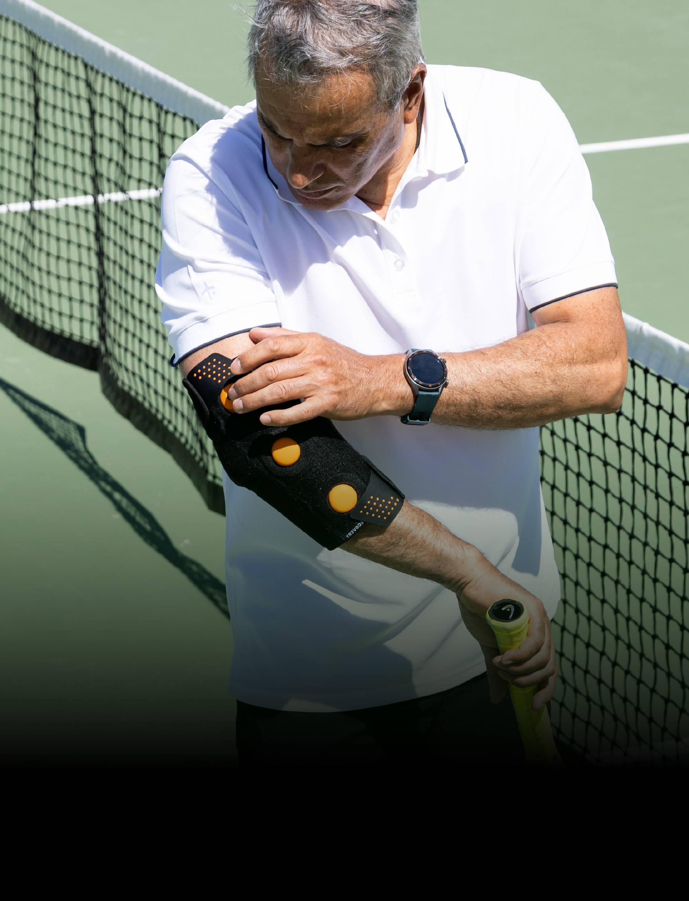 Older gentleman using Myovolt arm while playing tennis