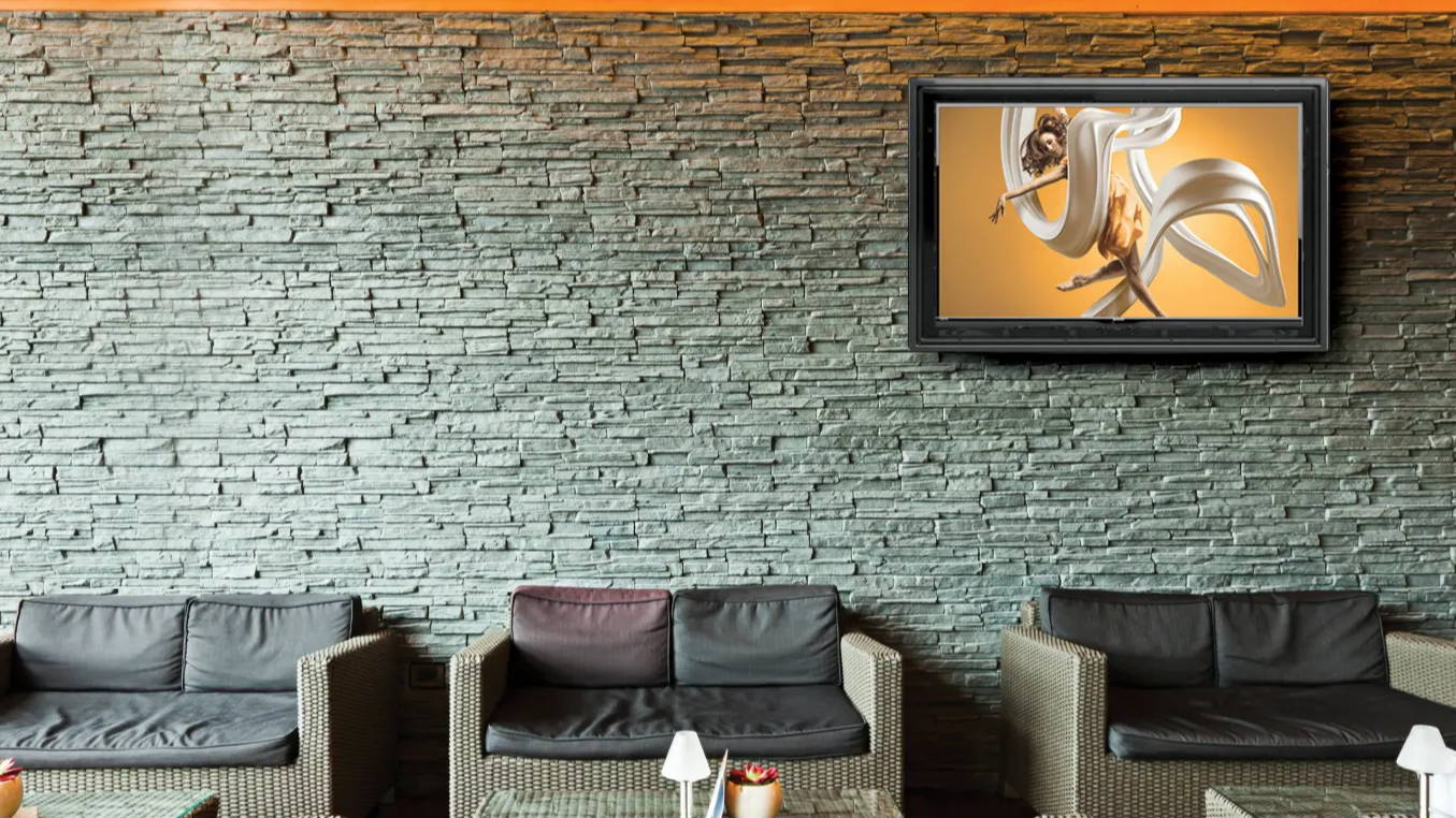 Commercial TV screen protection and security on brick wall for business, restaurants, lobbys, more