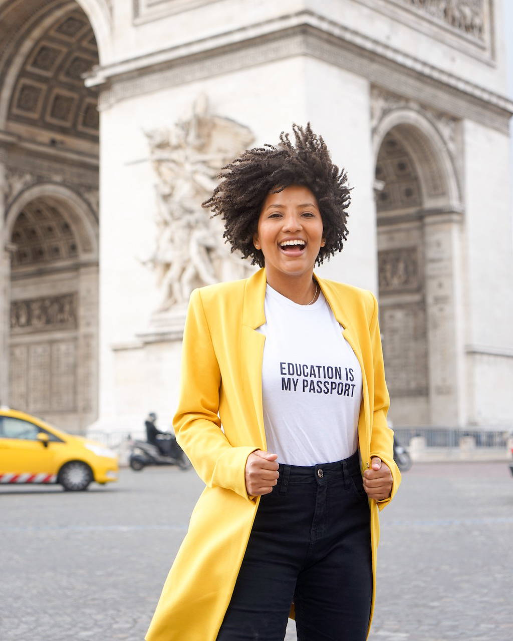 Thamara for The Blank Project wearing Education is my Passport white Tee in Paris