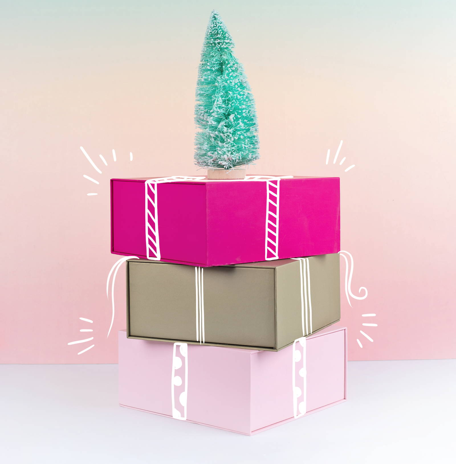 a cute image of pink and gold gift boxes with a turquoise christmas tree on topa