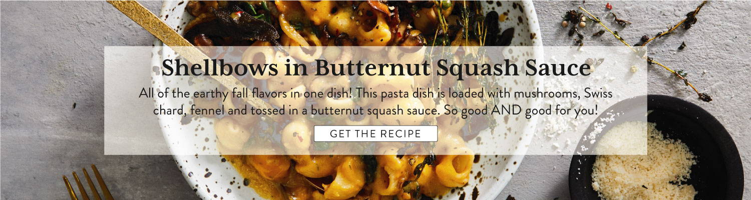 downshot of prepared pasta with butternut squash sauce, mushrooms, swiss chard and fennel in a bowl