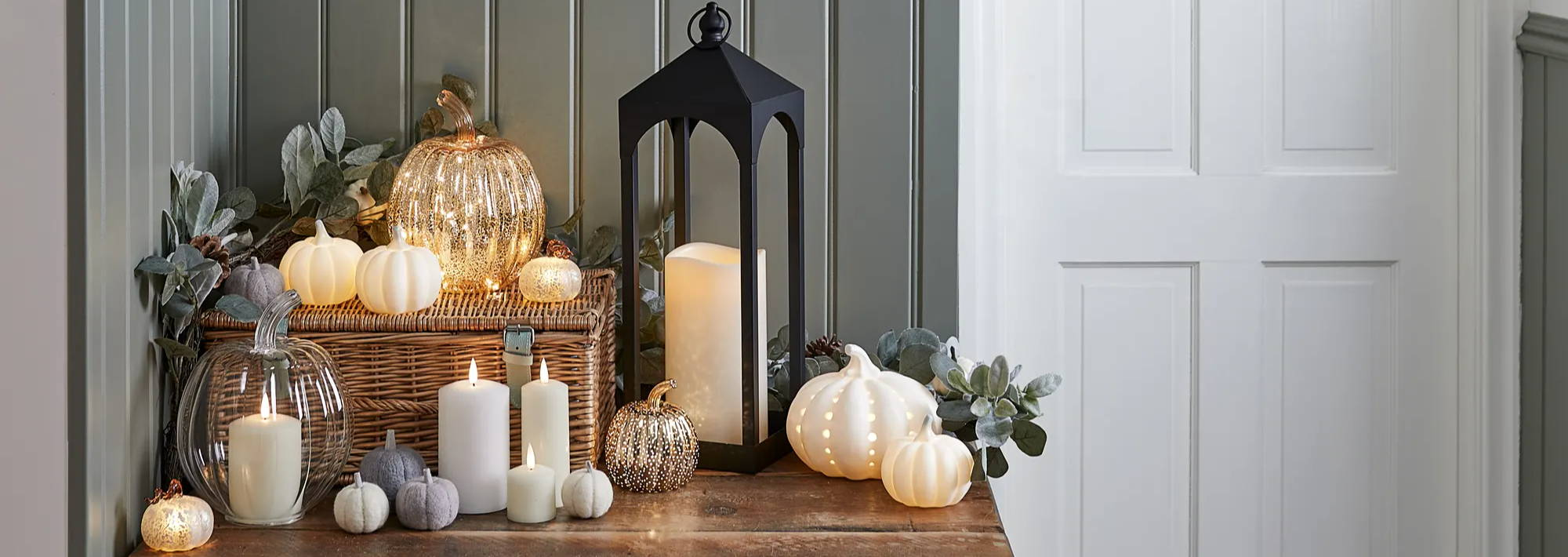 Fall table display with flameless candle lantern, pumpkin decor and TruGlow candles illuminated