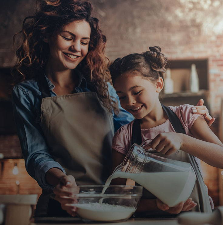 mom and daughter cooking together.