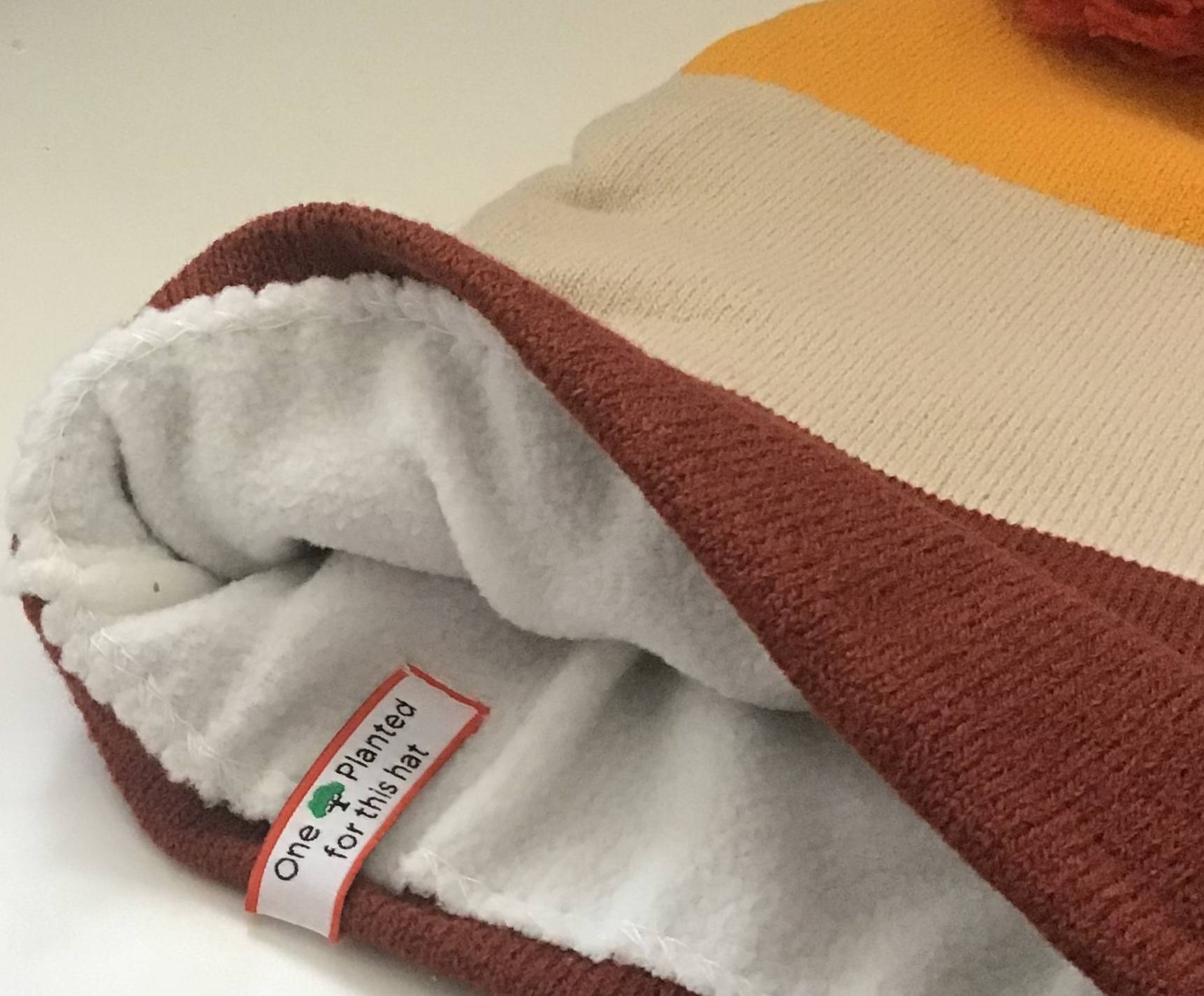 Fleece lined beanie with custom label
