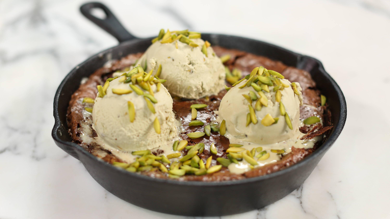 Pistachio Ice Cream on A Gooey Brownie Skillet