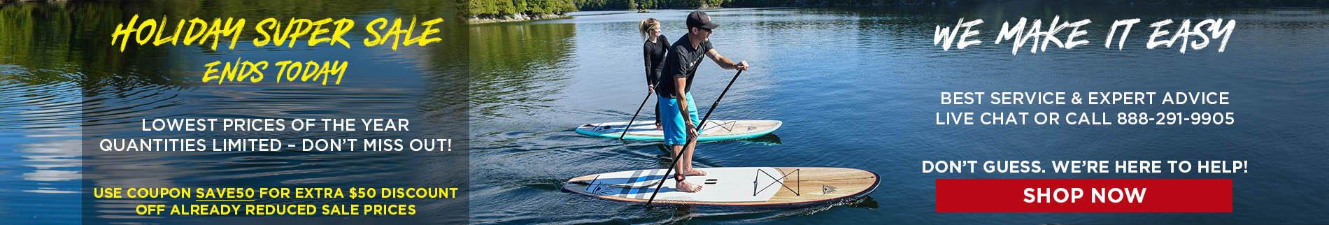 a couple of paddle boarders enjoying a lake