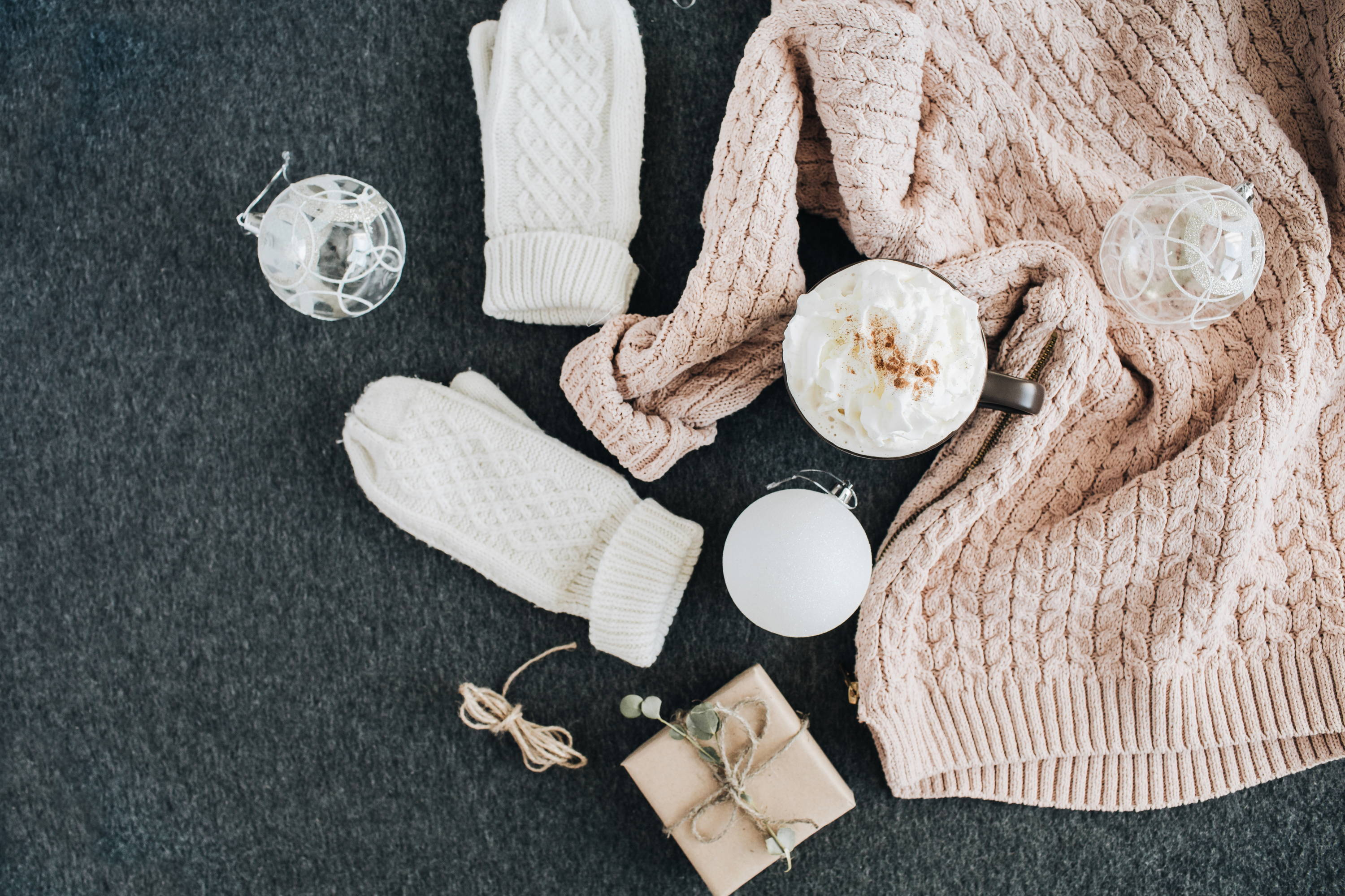 sweater, mittens, gifts on a table