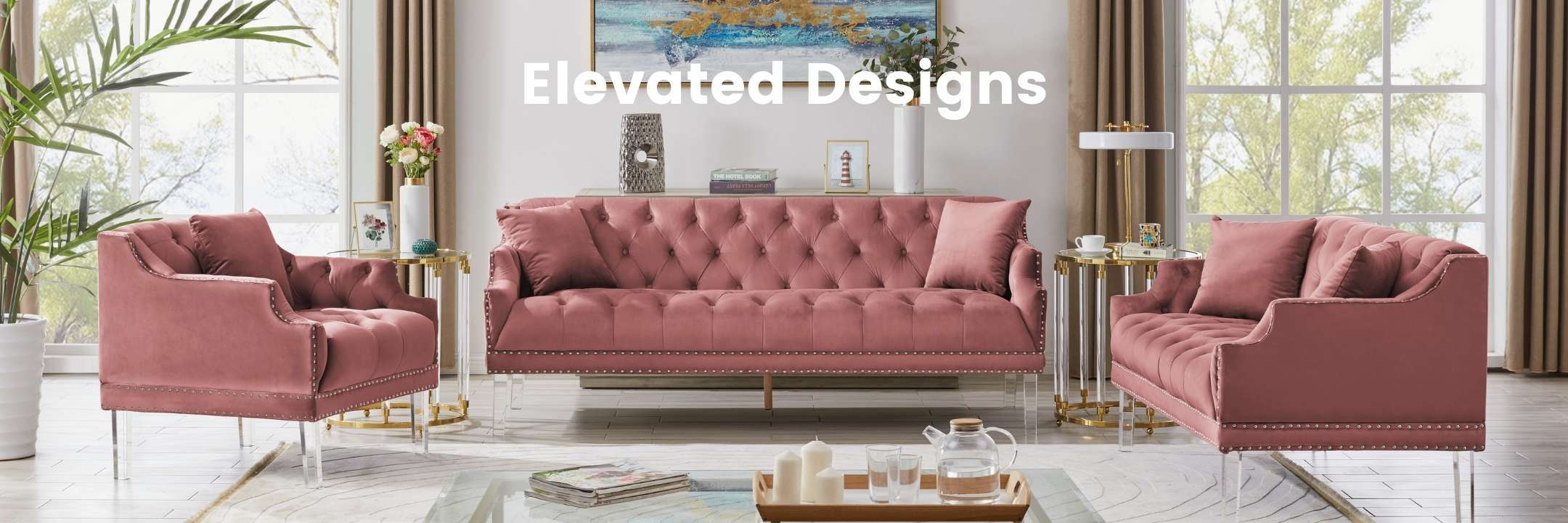 A living space with a blush Iconic Home Elsa velvet sofa, loveseat and club chair