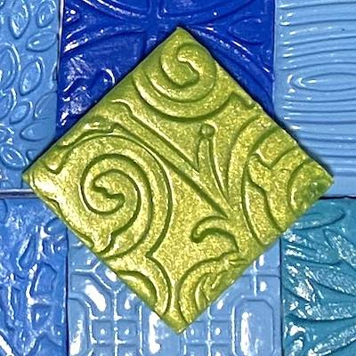 Stamped polymer clay tiles