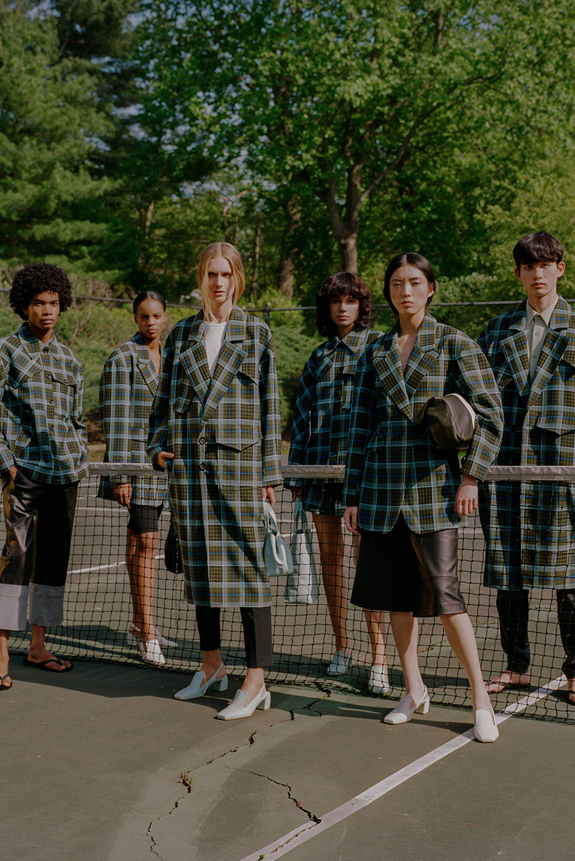Group of models wearing spencer plaid group from Resort 2020.