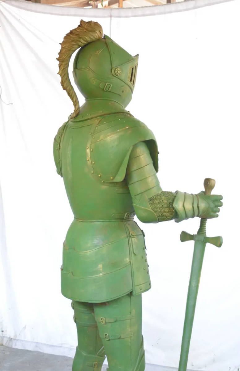 A photo of the back of a knight holding a sword