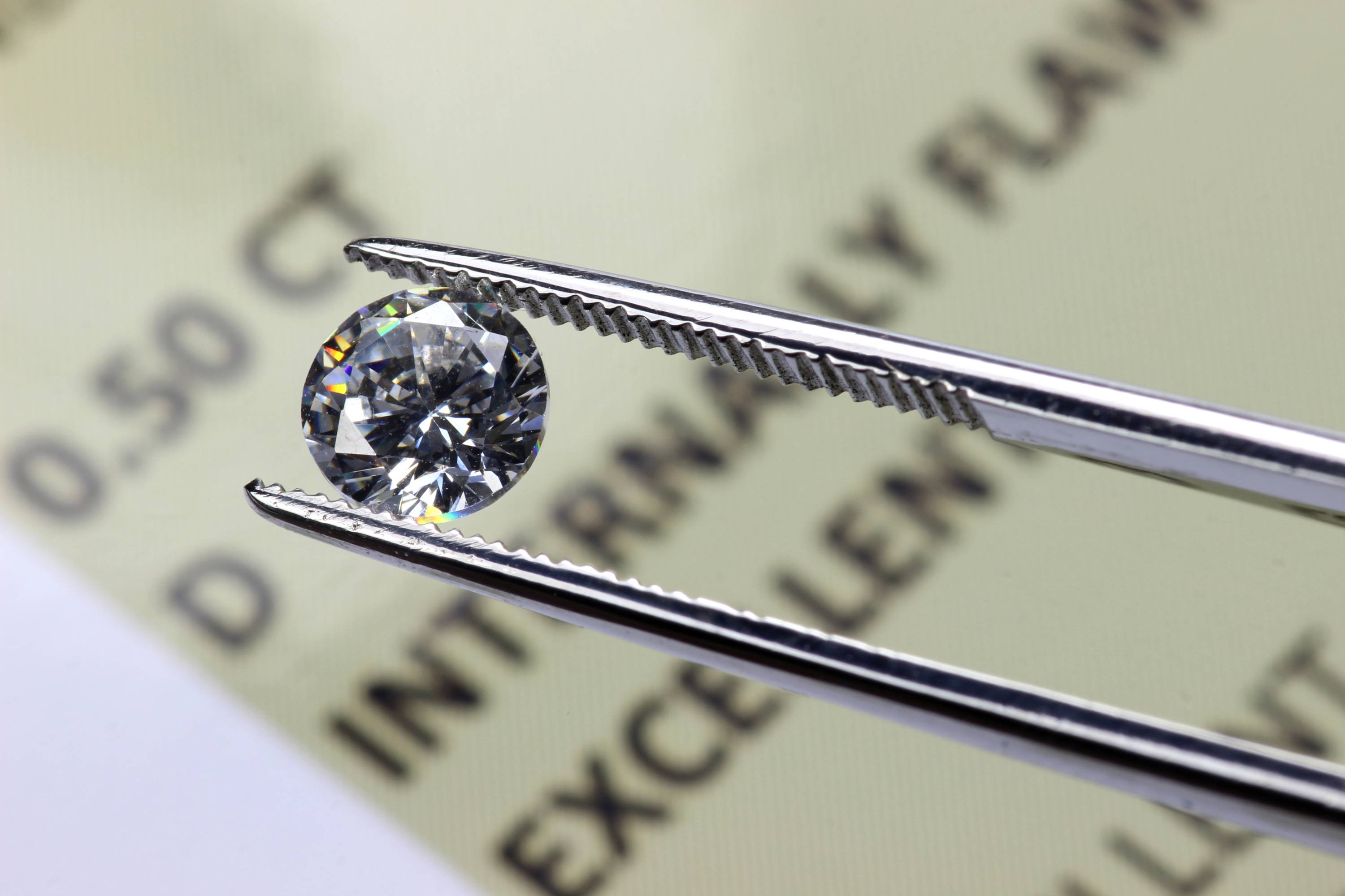 brilliance of a lab-grown diamond, held in tweezers