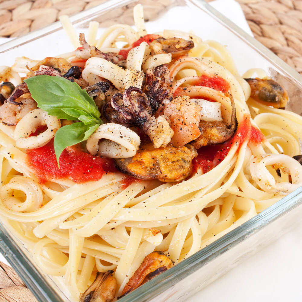 calamari with basil and tomatoes over pasta
