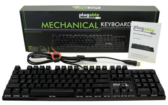104-key keyboard in front of its packaging along with included items