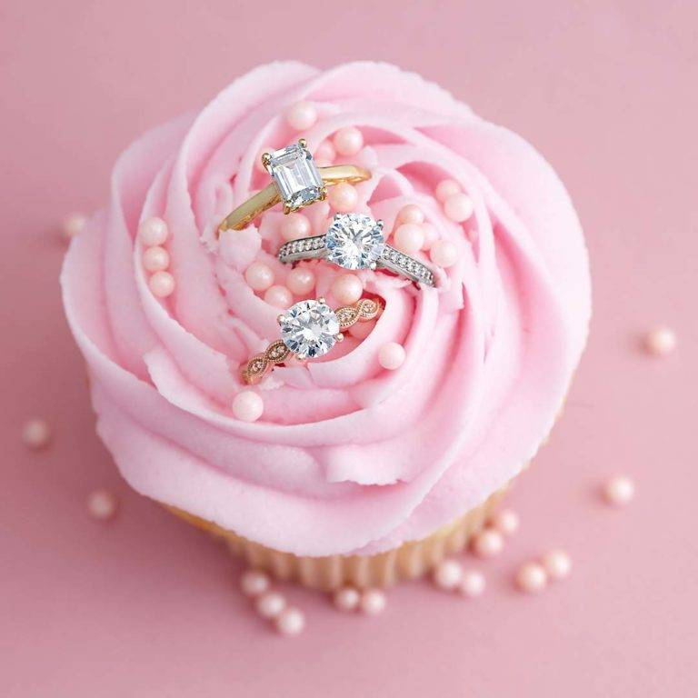 Rose cupcake with engagement rings