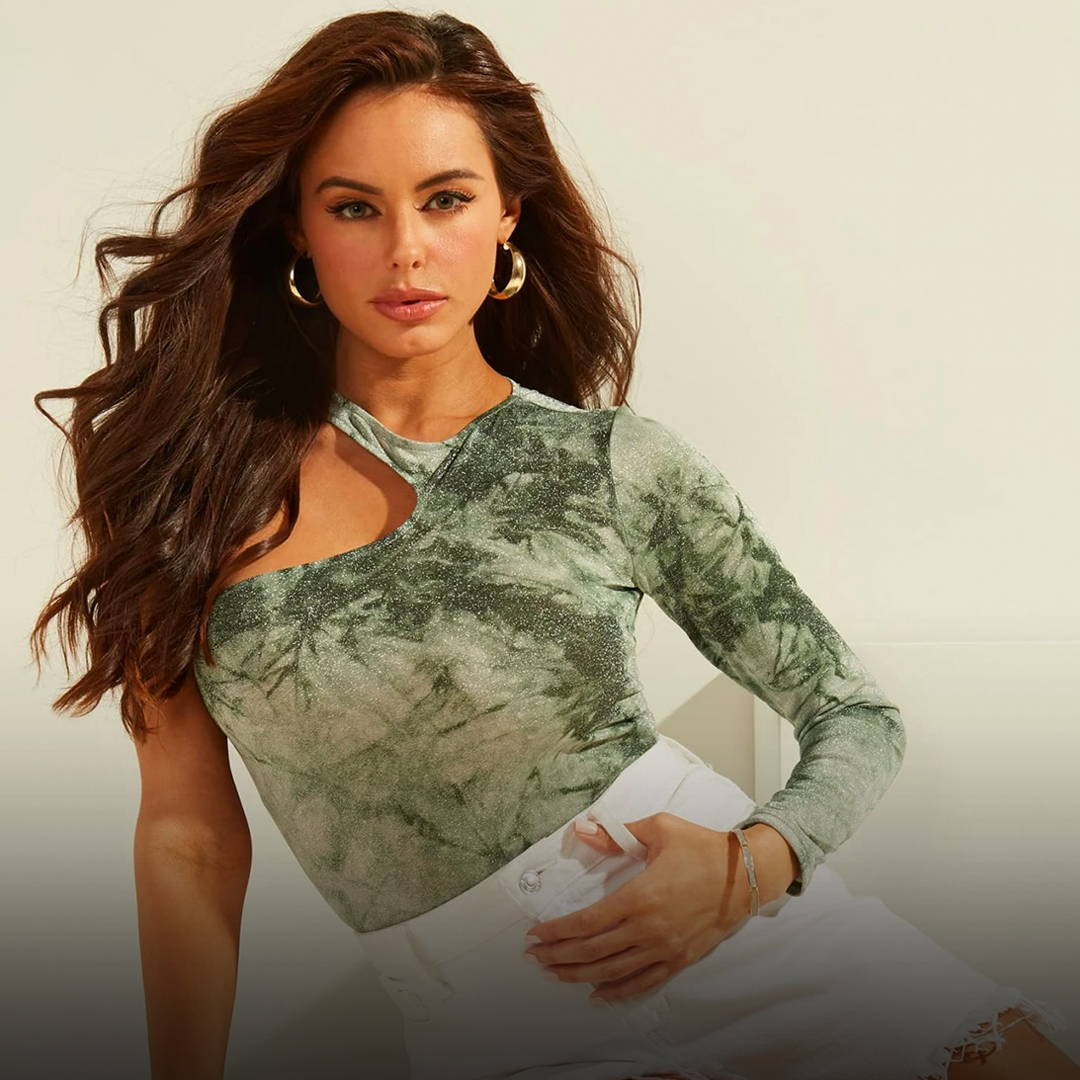 A woman wearing a Guess Fashion top