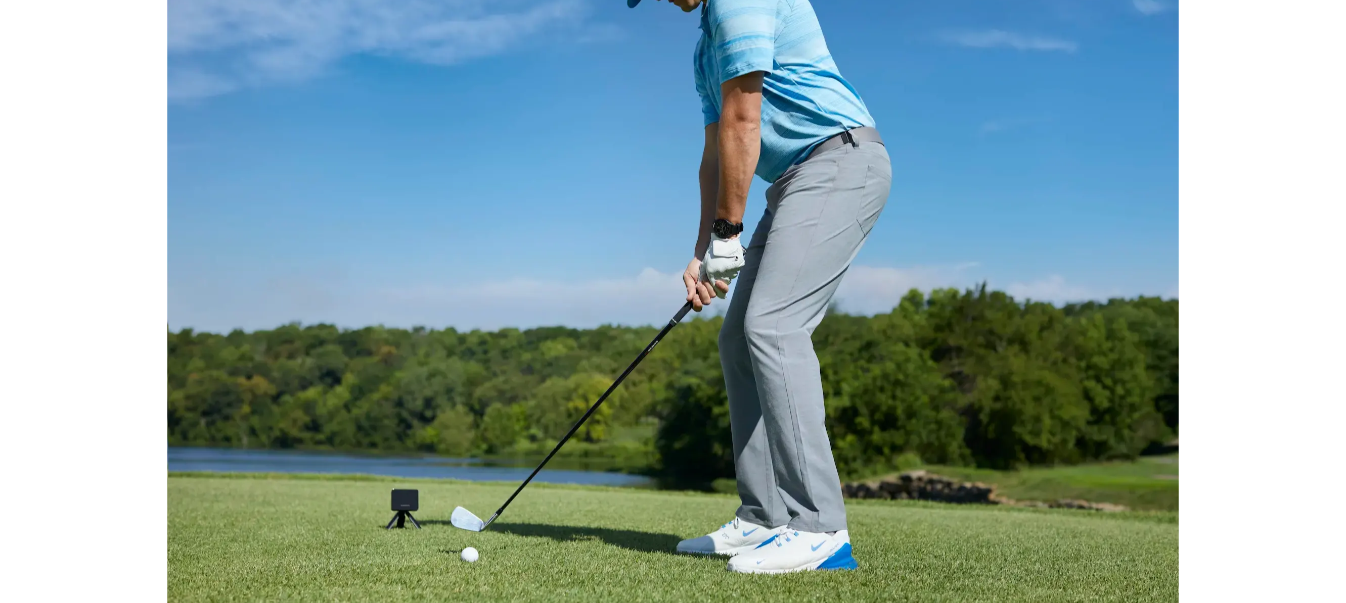 Golfer using the Garmin Approach R10 portable launch  monitor on the course