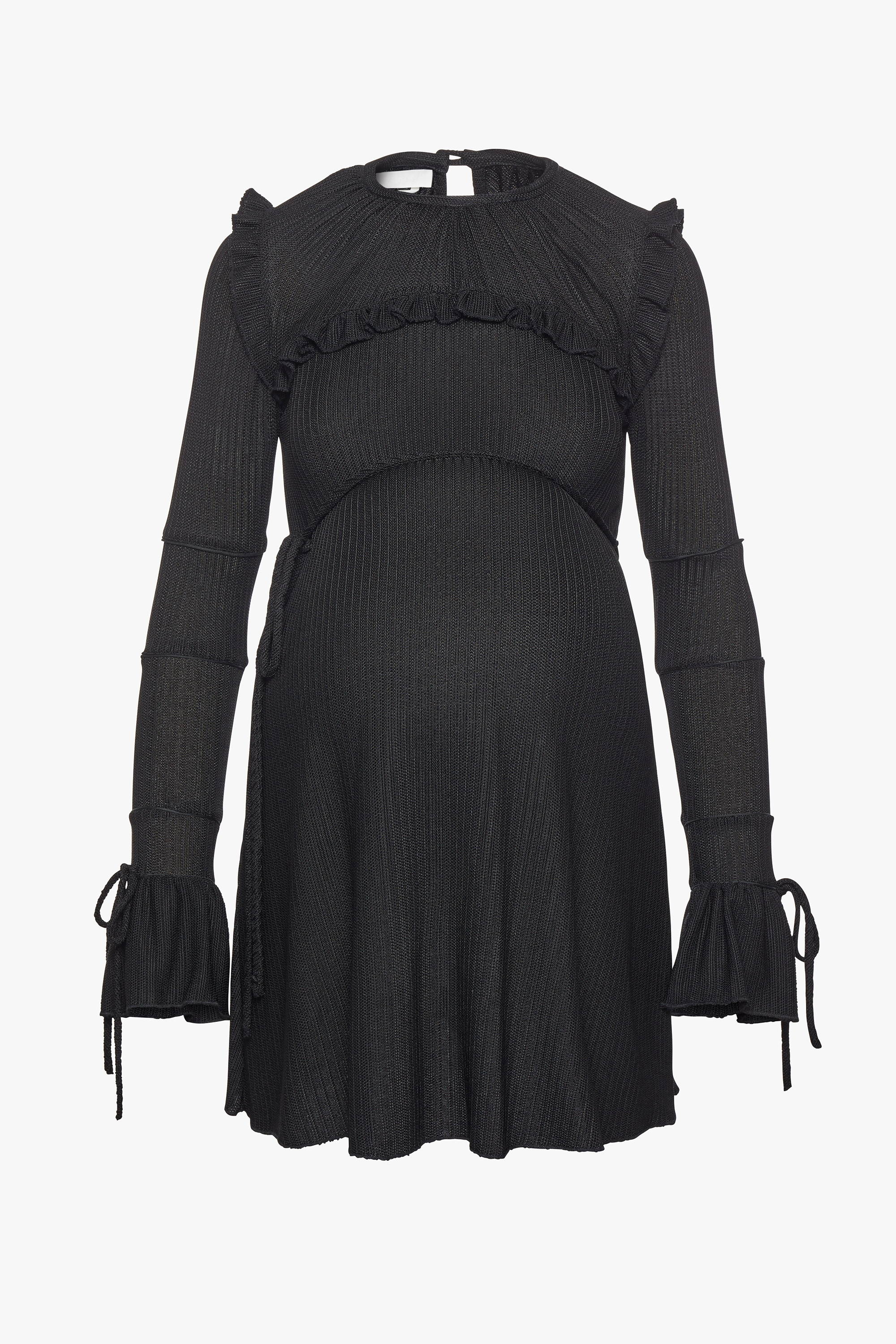 The maternity friendly Wonderland dress in black knit