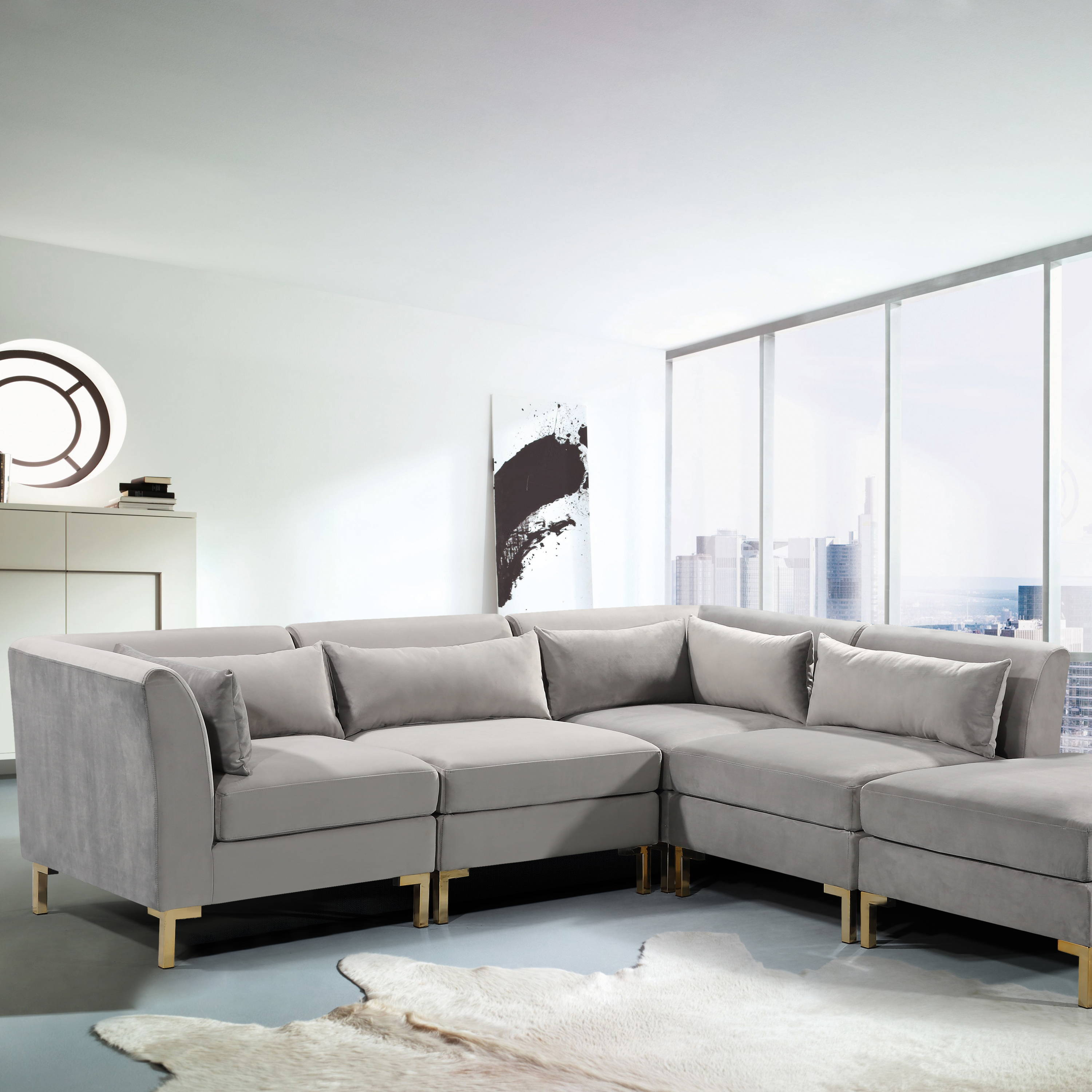 A living room with the grey Iconic Home Girardi modular sectional sofa in the middle
