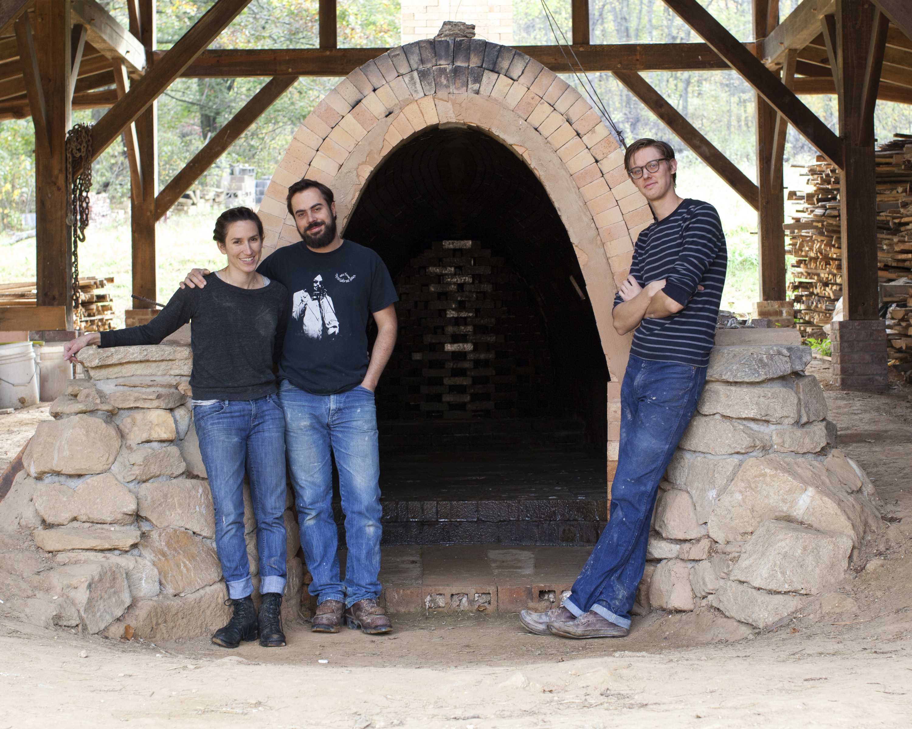 Connie, Alex and John outside the wood fired kiln.