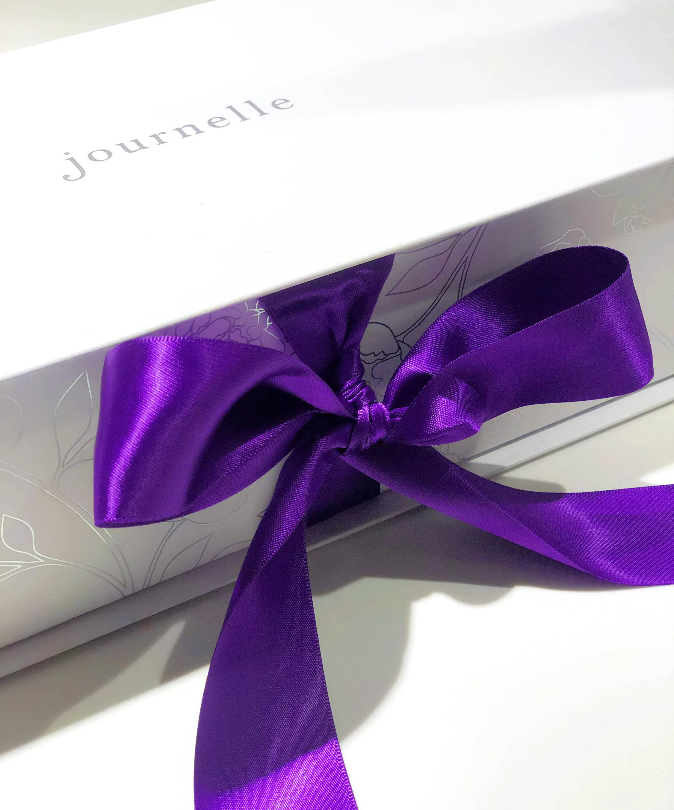 Journelle Holiday Gift Box pagacking in luxury white box with purple ribbon