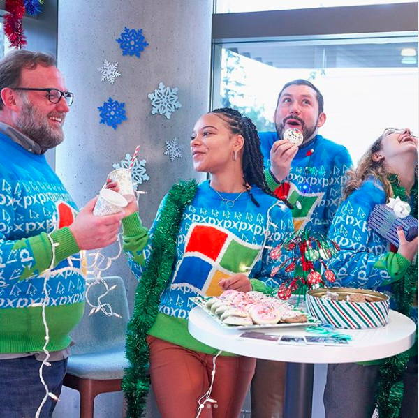 Team in Windows Christmas Sweaters
