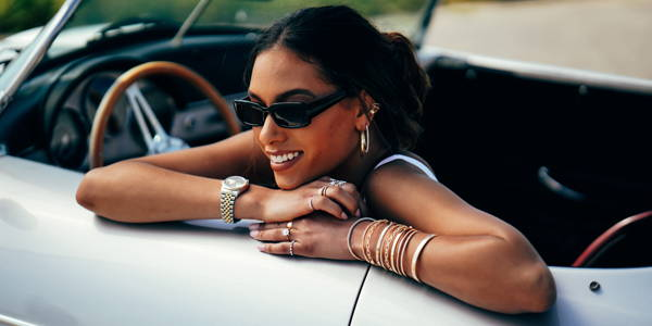 Model wearing Ring Concierge jewelry sitting in car