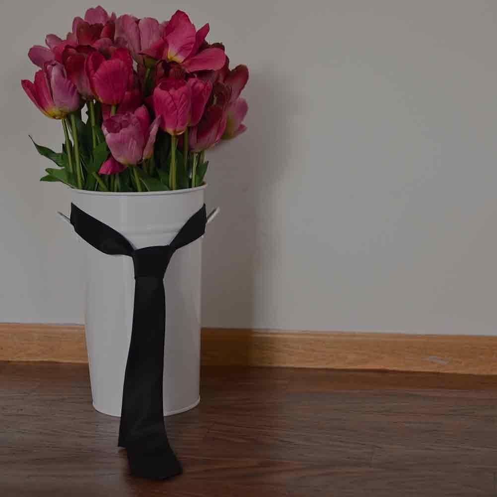 Black necktie wrapped around flowers