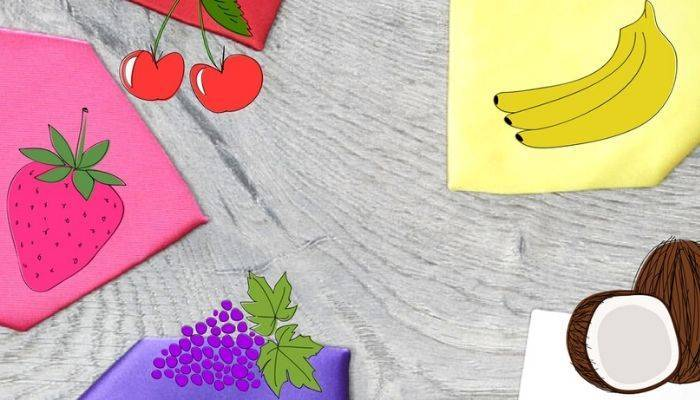 Colorful scented ties with cartoon fruit overlay
