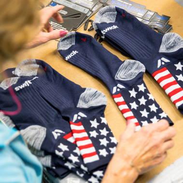 Woman sorting Swiftwick socks