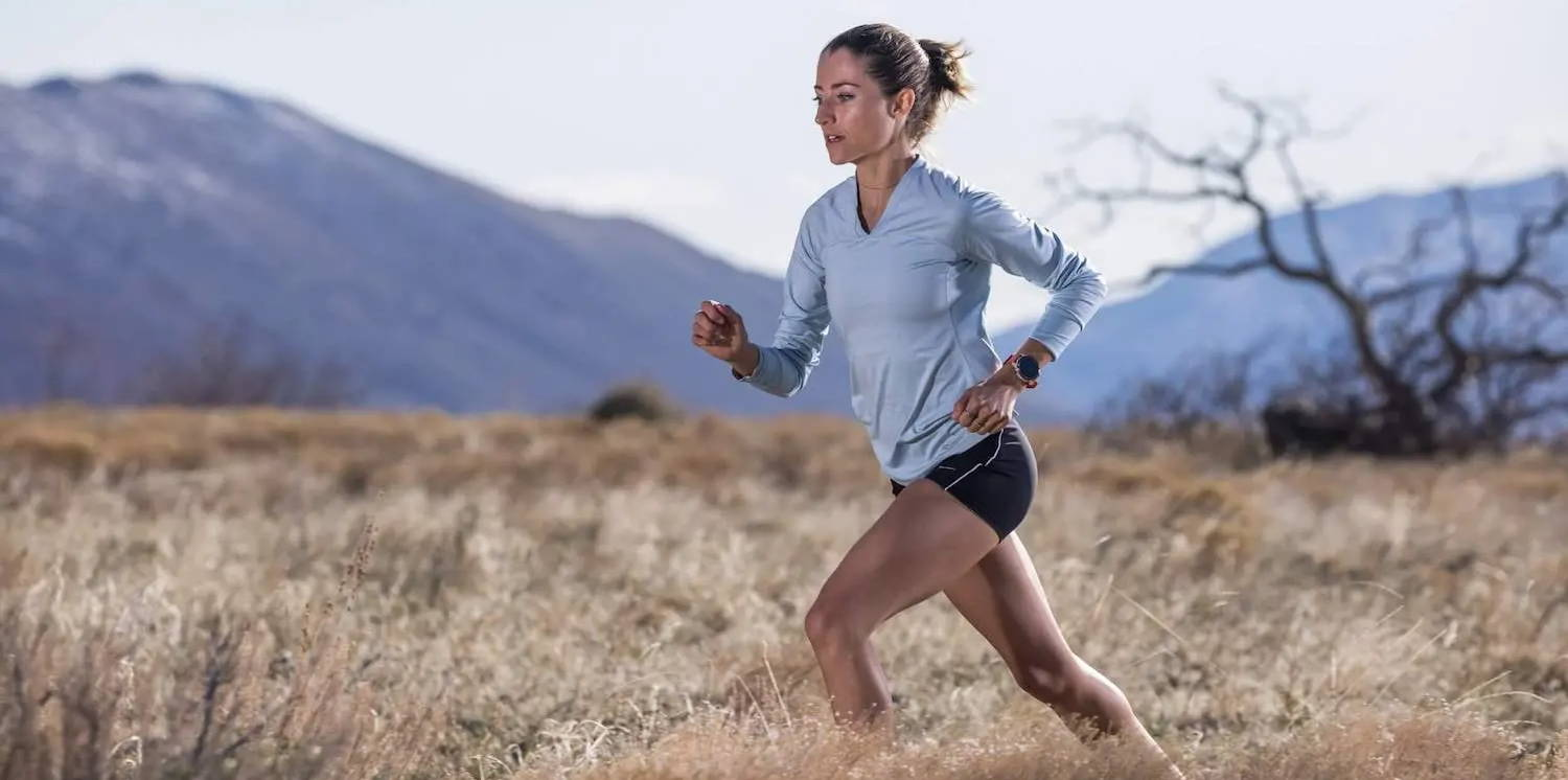 Woman running with COROS watch