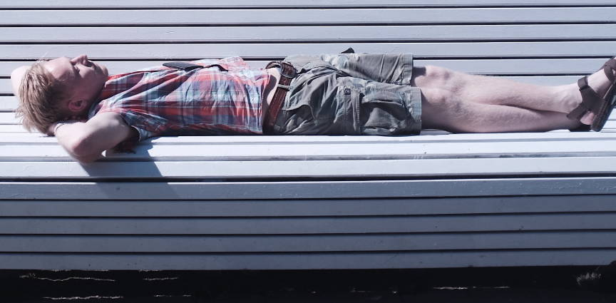 remfit lack of sleep guide. guy sleeping on bench