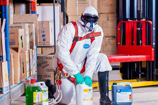 A Man Wears A Respirator and Tyxex Suit