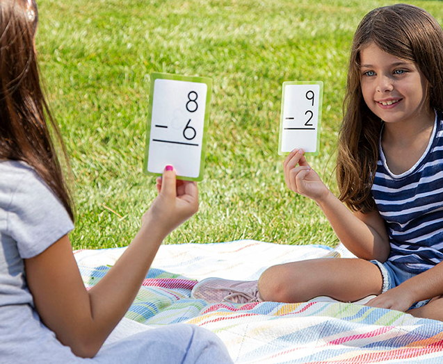 Small children using flash cards to learn about math