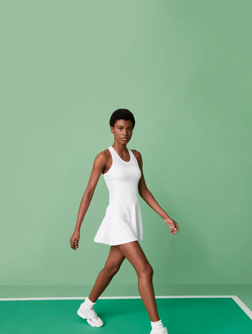 Tennis Capsule is Here. Click now to Shop the Capsule. Photo featuring our Serena Dress in White.