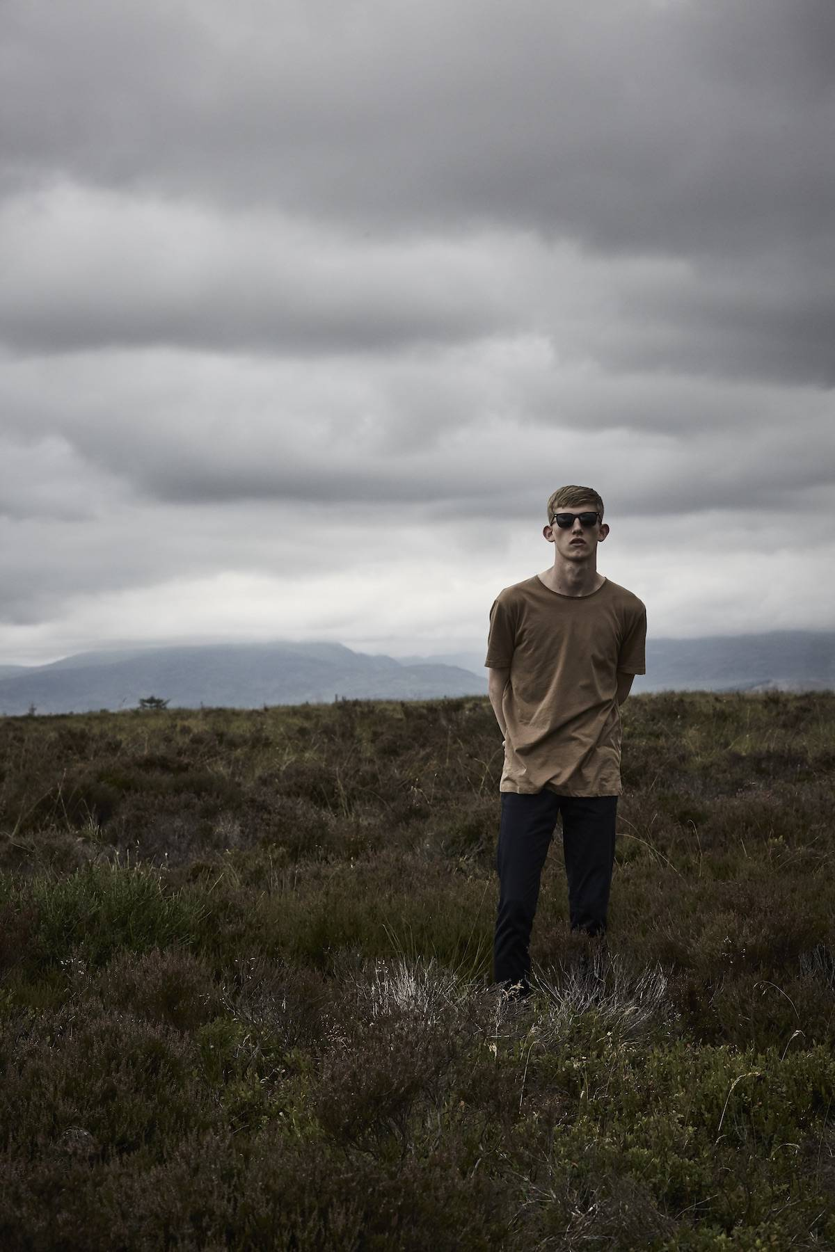 Scottish model Connor Newall on a stormy moor for Kartel Scotland watches AW18 campaign
