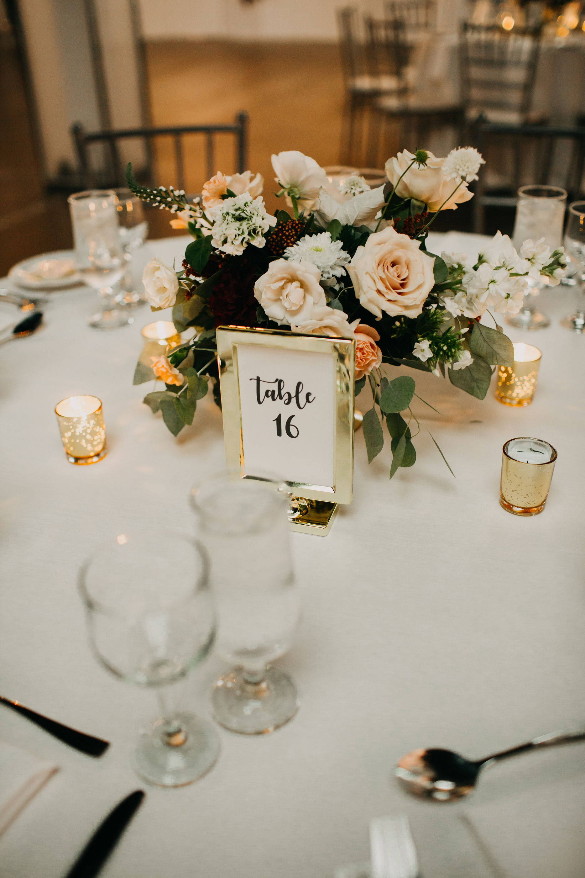 Centerpiece at The Warehouse wedding in Toronto from florist May Flowers