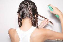 Lady braiding hair