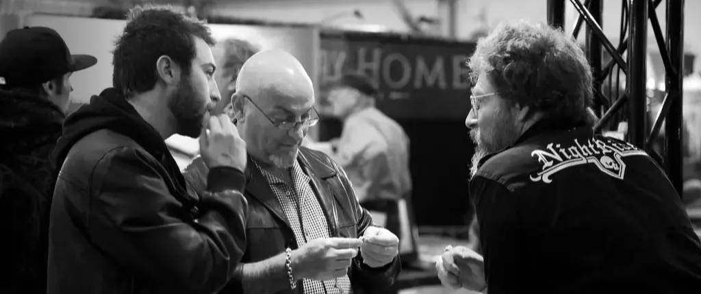 A NightRider Road Show Team Member talking with customers at an event