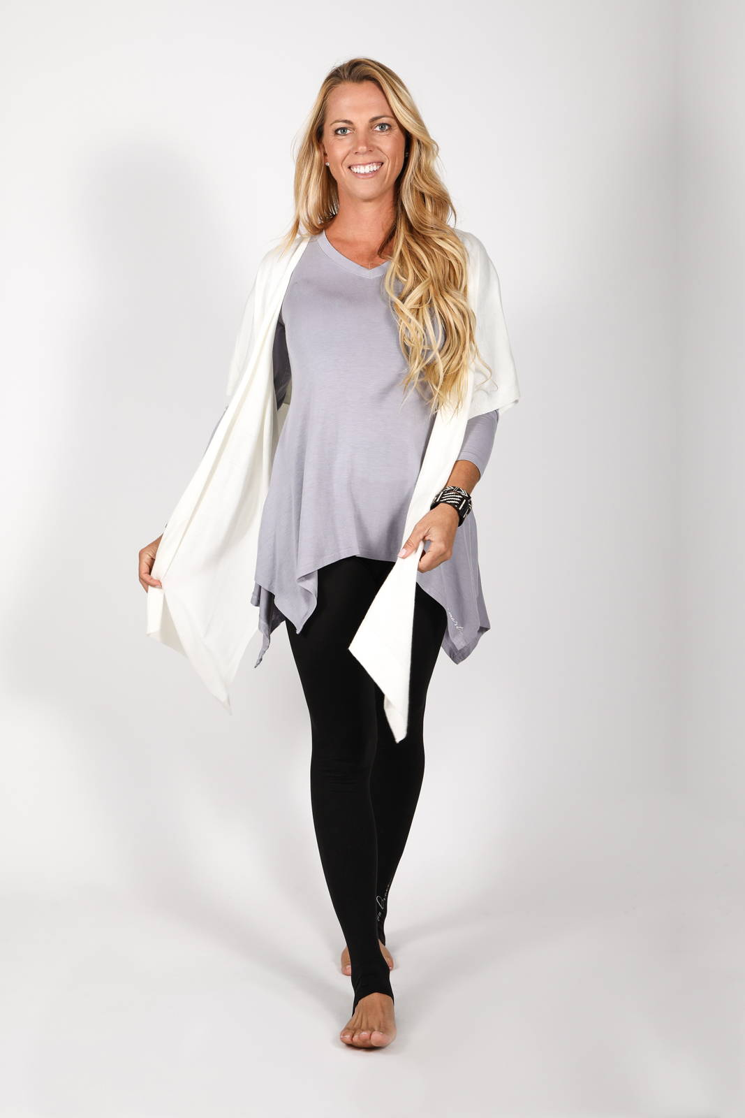 Model wearing the Solas Top with the Lux Kimono in White and the Lumo Legging by illuminative
