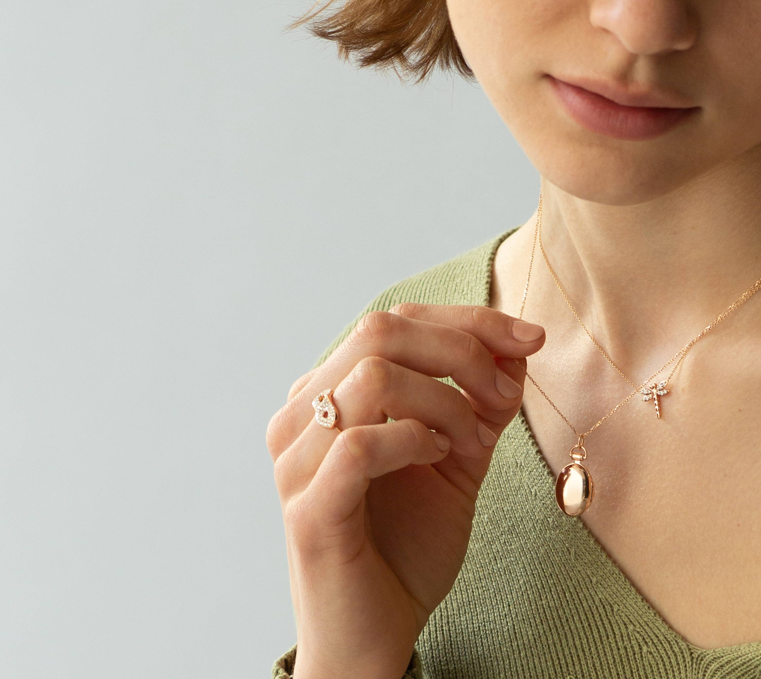 Delivering more quality in every piece. Woman in Rose Gold jewelry