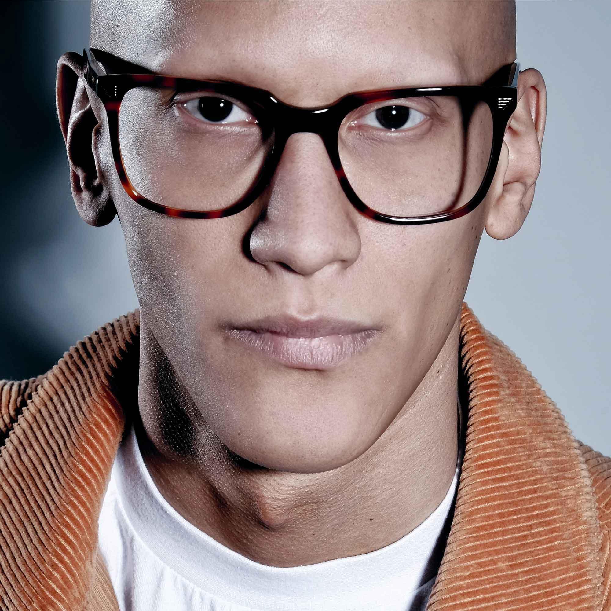 Male model wearing joiuss kent tortoiseshell glasses