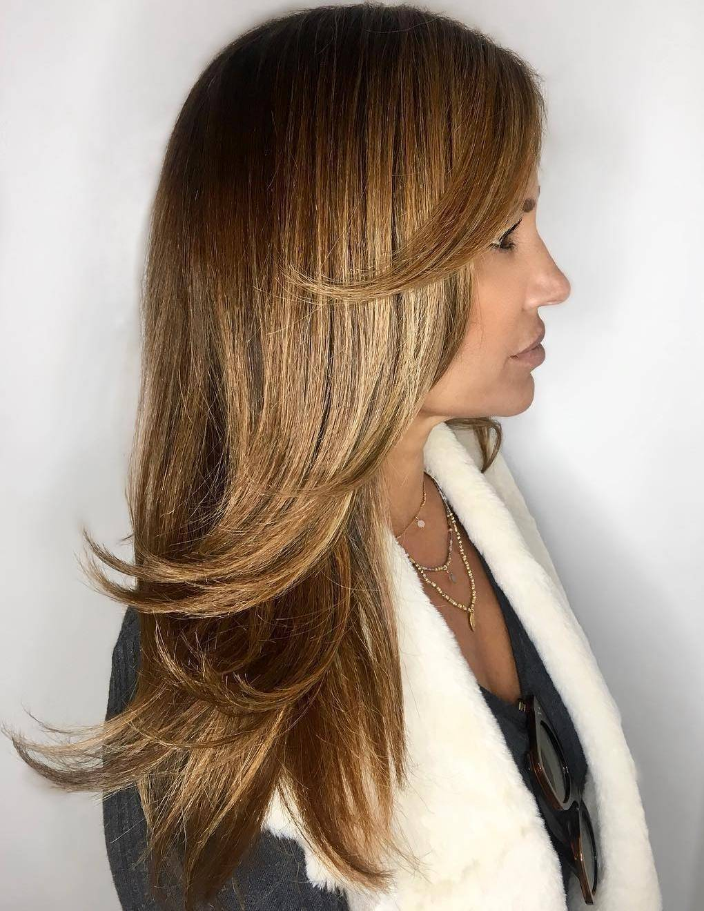 Woman with brown swoopy layered hair